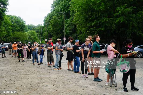 People wait in line to vote in Georgia's Primary Election on June 9, 2020 in Atlanta, Georgia. Georgia, West Virginia, South Carolina, North Dakota,...