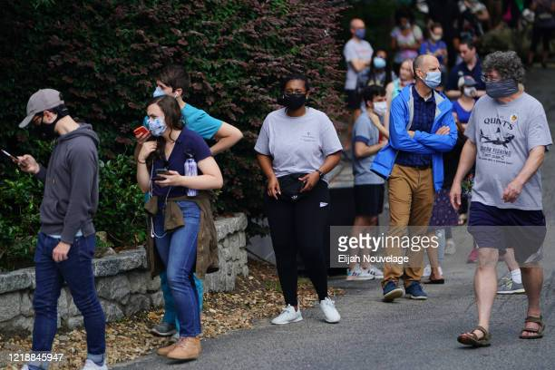 People wait in line to vote in Georgia's Primary Election on June 9 2020 in Atlanta Georgia Georgia West Virginia South Carolina North Dakota and...