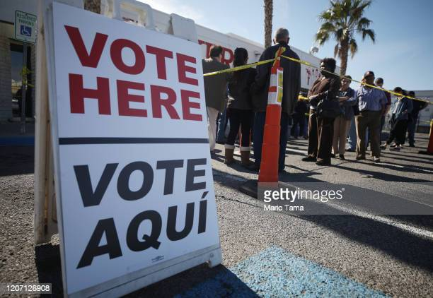 People wait in line to vote on the final day of early voting for the upcoming Nevada Democratic presidential caucus on February 18 2020 in Las Vegas...