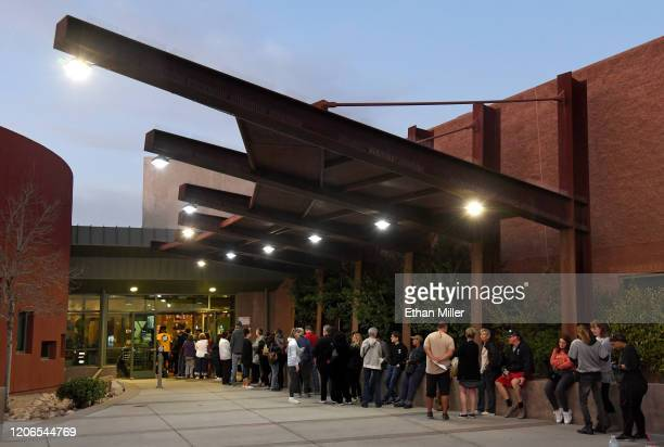 People wait in line to vote on the first day of early voting for the upcoming Nevada Democratic presidential caucus at the Centennial Hills Community...