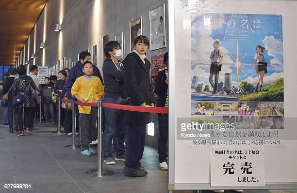 People wait in line to watch the Japanese animation film 'your name' at a movie theater in Hida Gifu Prefecture on Nov 6 2016 A month later the...