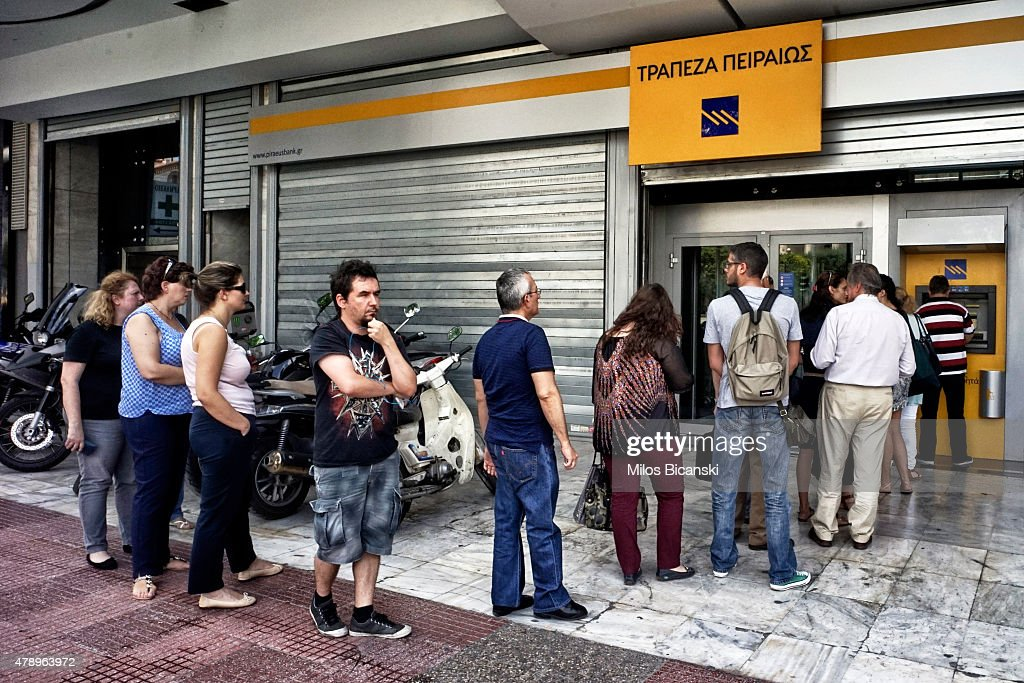 People wait in line to withdraw 60 euros from an ATM after Greece closed its banks on June 29, 2015 in Athens, Greece. Greece closed its banks and imposed capital controls on Sunday to monitor the growing strains on its crippled financial system, bringing the prospect of being forced out of the euro into plain sight.