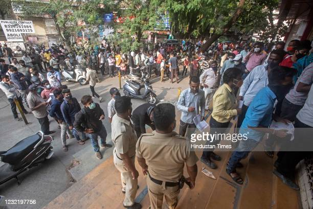 People wait in queue to buy Remdesivir injection at Chemist association, on April 8, 2021 in Pune, India.