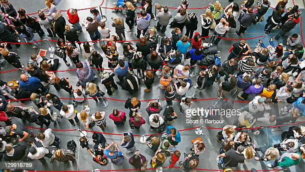 people wait in queues - lining up stock pictures, royalty-free photos & images