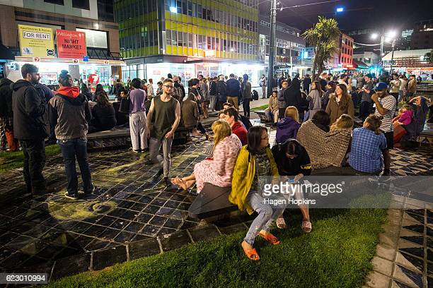 People wait in Te Aro Park after being evacuated from nearby buildings following an earthquake on November 14 2016 in Wellington New Zealand The 75...
