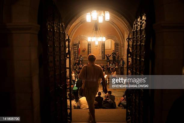 People wait in the crypt level to begin a tower climb at the National Cathedral on March 24 2012 in Washington DC The cathedral opened the central...
