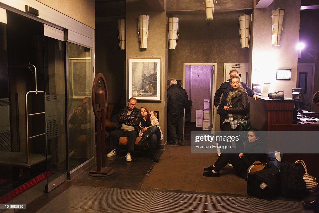 People wait in the lobby of the Hampton Inn Manhattan-SoHo after the power went out on October 29, 2012 in New York City. A large part of Manhattan below 26th St. has lost power reportedly because of flooding.