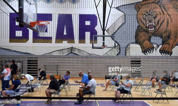 People wait in the observation area after receiving COVID-19 vaccinations at a clinic at Winter Springs High School. As of September 10 54% of...