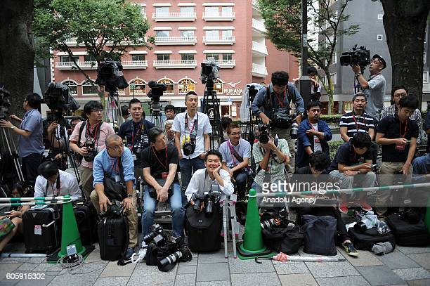 People wait in the queue in front of a telecom shop in Omotesando Avenue in Tokyo Japan on September 16 2016 Apple has released for sale its new...