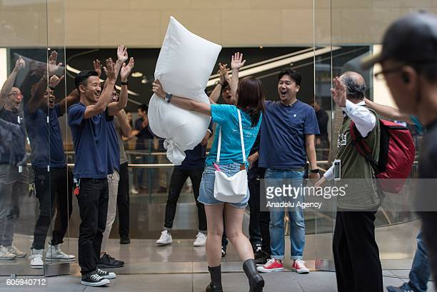 People wait in the queue in front of an Apple Store in Omotesando Avenue in Tokyo Japan on September 16 2016 Apple has released for sale its new...