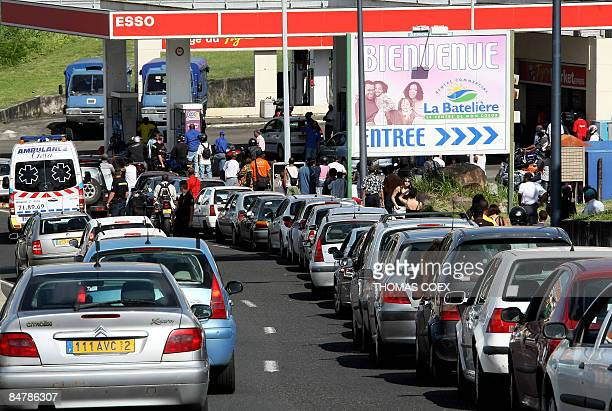People wait in their car in a severalkilometer long queue attempting to fill their tanks at a gas station in FortdeFrance Martinique on February 13...