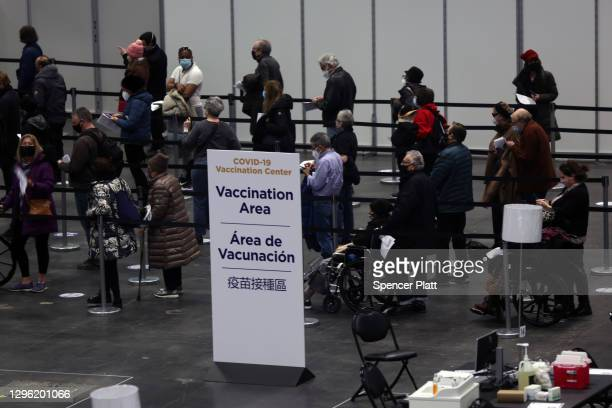 People wait inside Manhattan's Javits Center which recently opened as a COVID vaccination site on January 13, 2021 in New York City. The Javits,...