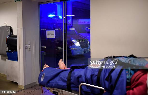 A person lies down on a stretcher inside the emergency department of the hospital of Trousseau in Tours on January 12 2017 during a major flu...