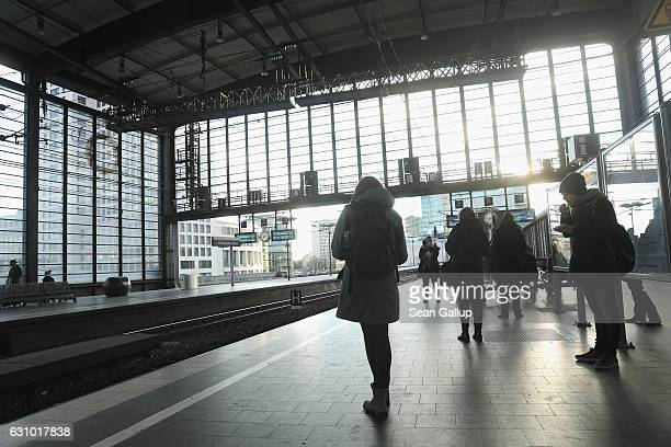 People wait on a train platform at the Zoo railway station on January 5 2017 in Berlin Germany Anis Amri the Tunisian man German authorities are...