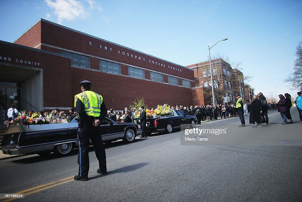 People wait on line to attend the funeral for 29-year-old Krystle Campbell who was one of three people killed in the Boston Marathon bombings on April 22, 2013 in Medford, Massachusetts. The 29-year-old restaurant manager was raised in Medford. Massachusetts Gov. Deval Patrick has asked residents to observe a moment of silence at the time of the first explosion at 2:50 p.m. this afternoon.