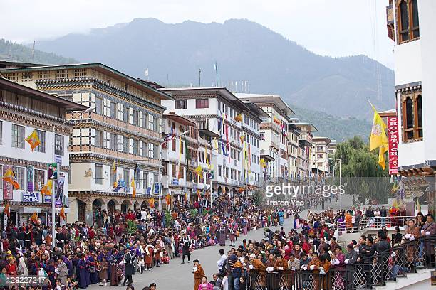 People wait on the main street for the arrival of the Royal Couple His Majesty King Jigme Khesar Namgyel Wangchuck and Her Majesty Queen Ashi Jetsun...