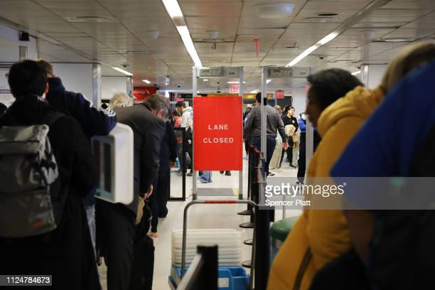 People wait on the security screening line at LaGuardia Airport after the Federal Aviation Administration announced it is delaying flights into...