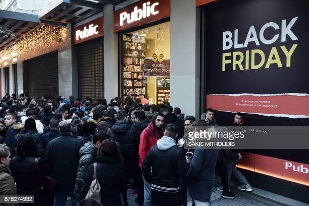 People wait outside a department store in Thessaloniki on November 24 2017 Long queues snaked outside department stores for the Black Friday shopping...