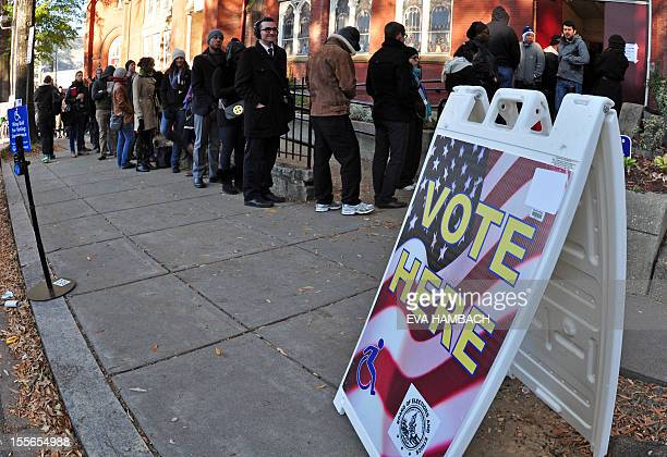 People wait outside MtBethel Baptist Church in Washington DC on November 6 2012 as Americans headed to the polls Tuesday after a burst of lastminute...