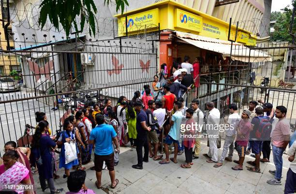 People wait outside PMC bank after the Reserve bank of India Thane based Punjab and Maharashtra Co-operative Bank under directions for six months...