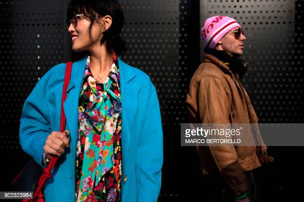 TOPSHOT People wait outside prior to the women's Fall/Winter 2018/2019 collection fashion show by Gucci in Milan on February 21 2018