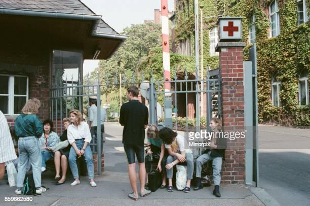 People wait outside Red Cross centre in East Berlin Germany 22nd September 1989 As with many organisations the centre is suffering from a shortage of...