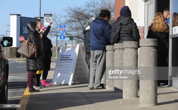 People wait outside the Best Buy at South Bay in Boston to pick up their purchases on March 22 2020 Best Buy started offering contactless curbside...