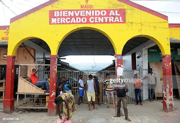 People wait outside the closed Malabo Market on April 25 2016 in Malabo Equatorial Guinea Africa's longestserving leader President Teodoro Obiang...