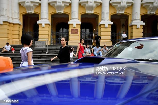 People wait outside the Hanoi Opera house on February 9 2019 US President Donald Trump announced on February 8 that his upcoming summit with North...