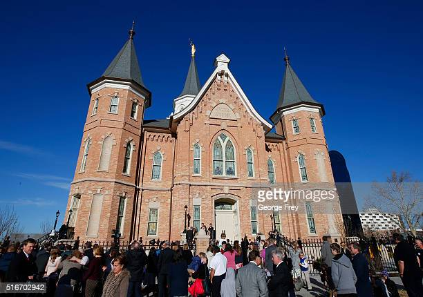People wait outside the Provo City Center Temple of the Church of Jesus Christ of Latter Day Saints to attend the dedication on March 20 2016 in...