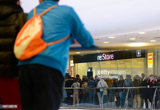 People wait outside the reStore at Europeisky Shopping Mall in Moscow as iPhone 6 and iPhone 6 Plus retail sales begin in Russia on September 25 2014