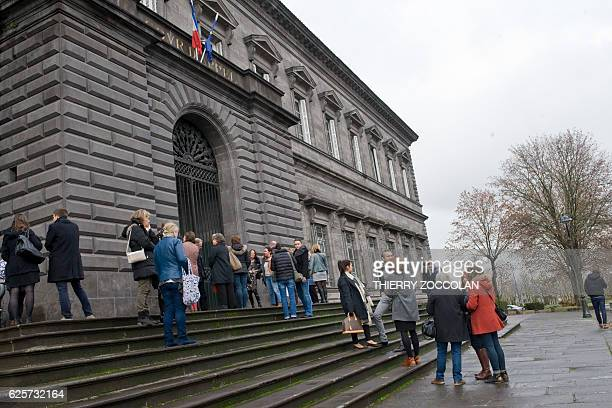 People wait outside the Riom courthouse on November 25 2016 on the 10th day of the trial of Cecile Bourgeon and Berkane Makhlouf charged in relation...