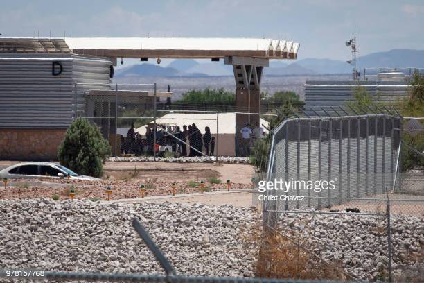 People wait outside the TornilloMarcelino Serna Port of Entry where tents have been built to house unaccompanied migrant children on June 18 2018 in...