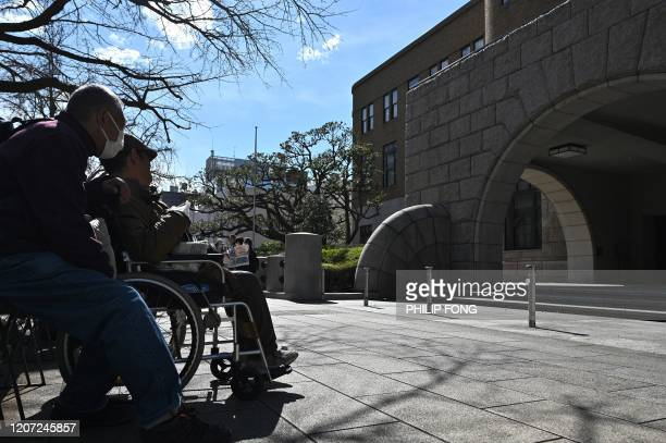 People wait outside the Yokohama district court on March 16 before the expected verdict of Satoshi Uematsu accused of the 2016 murder 19 disabled...