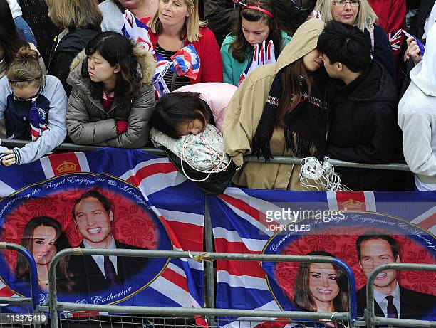 People wait outside Westminster Abbey ahead of the Royal Wedding of Britain's Prince William and Kate Middleton, on April 29, 2011. AFP PHOTO / WPA...