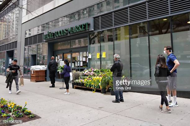 People wait outside Whole Foods amid the coronavirus pandemic on April 05, 2020 in New York City. COVID-19 has spread to most countries around the...