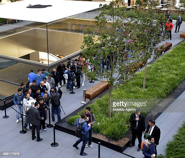 People wait outside Zorlu Center as iPhone 6 and iPhone 6 Plus retail sales begin at Apple Store in Zorlu Center on September 26 Istanbul Turkey
