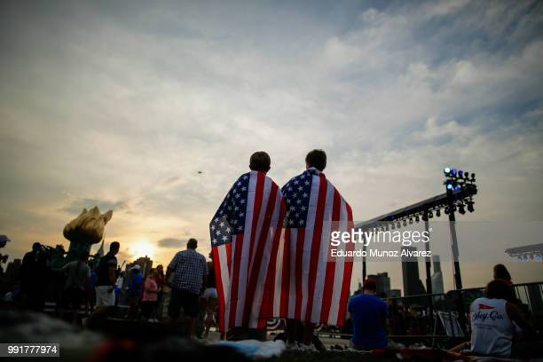 People wait the start of the Macy's Fourth of July Fireworks from Hunter Point Park on July 4 2018 in New York City