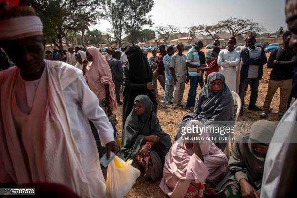 People wait their turn to cast their votes at Unguwar Sarki polling station in Kaduna on February 23 as Nigeria votes to elect its new president...