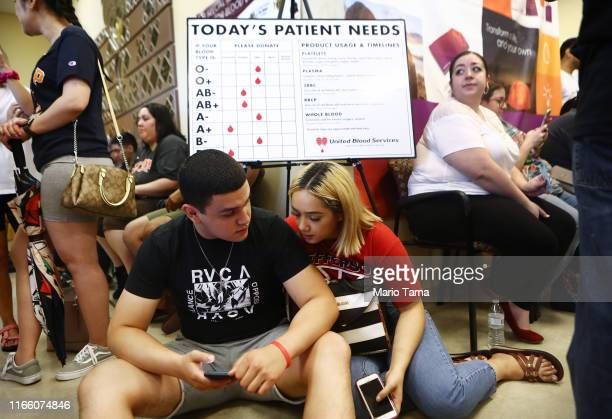 People wait their turn to donate blood at a Vitalant donation center the day after a mass shooting which left at least 20 people dead on August 4,...
