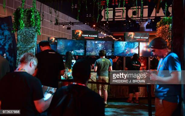 People wait their turn to get to play Tomb Raider at the 24th Electronic Expo or E3 2018 in Los Angeles California on June 12 where hardware...