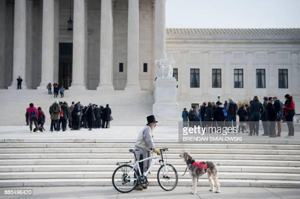 TOPSHOT People wait to attend public hearings outside US Supreme Court December 4 2017 in Washington DC / AFP PHOTO / Brendan Smialowski