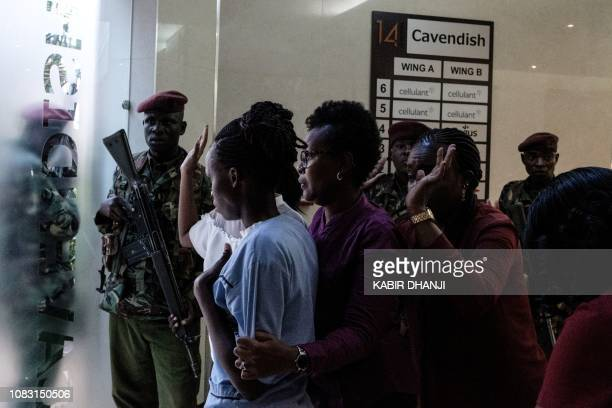 People wait to be evacuated after a bomb blast from the office block attached to DusitD2 hotel in Nairobi Kenya on January 15 2019 A huge blast...