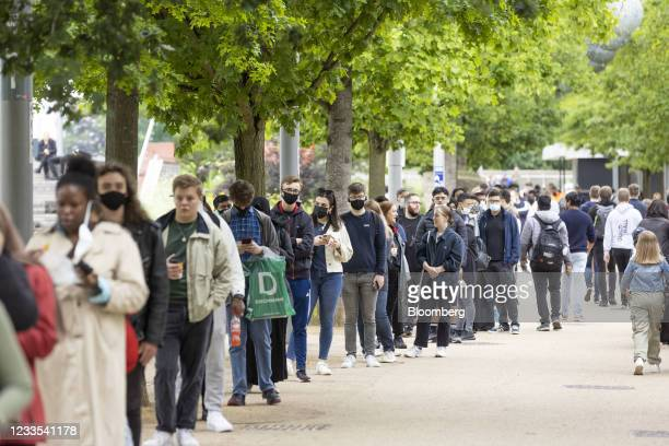 People wait to be inoculated at a mass vaccination event at the London Stadium in London, U.K., on Saturday, June 19, 2021. After inoculating a...