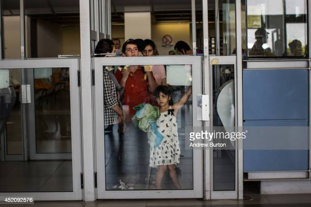 People wait to be let into Israel from Gaza during evacuations on the sixth day of Israel's operation 'Protective Edge' on July 12 2014 in Erez...