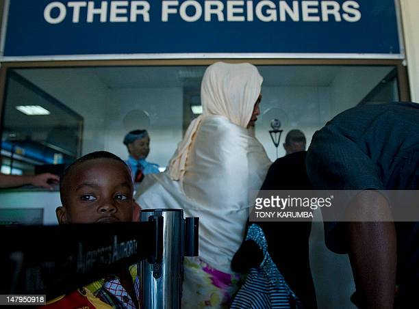 People wait to be processed by immigration officers at Zanzibar's Abeid amani Karume airport on July 6 after being repatriated from Somalia's capital...