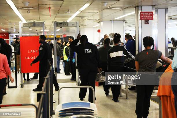 People wait to be screened by the TSA at LaGuardia Airport after the Federal Aviation Administration announced it is delaying flights into multiple...