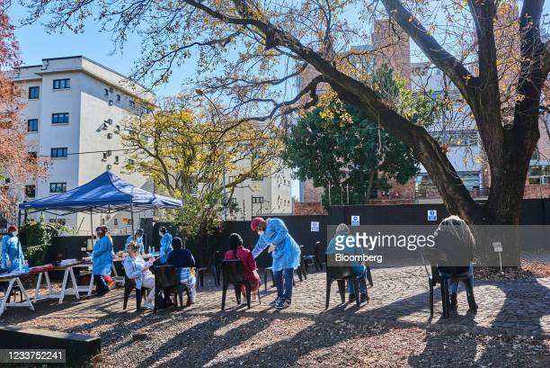 People wait to be swab tested at a Testaro Covid-19 testing site/laboratory in the Dunkeld suburb of Johannesburg, South Africa, on Thursday, July 1,...