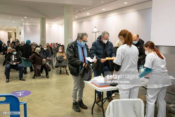 People wait to be vaccinated inside the Paris Stade de France following its conversion into a Covid-19 vaccination centre on April 7, 2021 in...