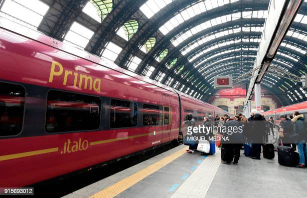 People wait to board an Italo train at the central train station in Milan on February 8 2018 The shareholders of Italian railways group ITALO have...
